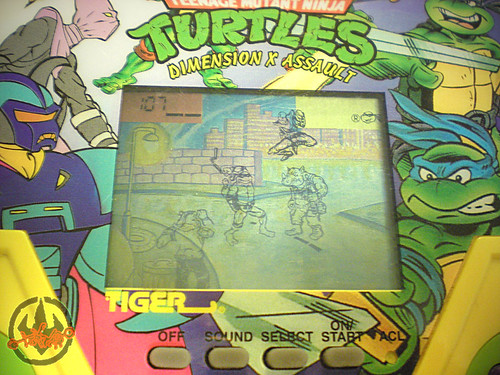 "TIGER ELECTRONICS :: ""TEENAGE MUTANT NINJA TURTLES: DIMENSION-X ASSAULT"" 'TALKING' ELECTRONIC LCD GAME  vii (( 1995 ))"