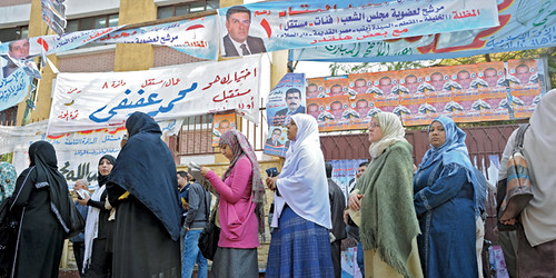 Egyptian voters line up at the polls in large numbers. Islamists have won the majority of the vote while capital pressures the country. by Pan-African News Wire File Photos