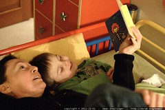 grandma neeta in sequoia's bed, reading him a bedtim…