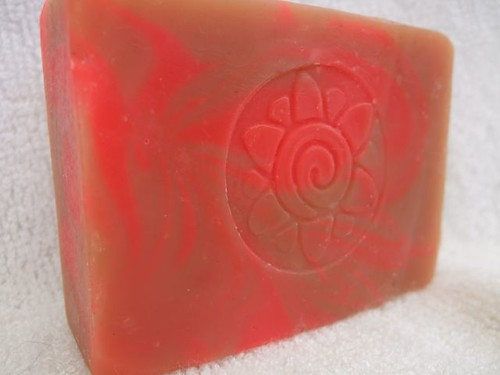 soap, tannish with a neon pink swirl, and a spiral flower stamp