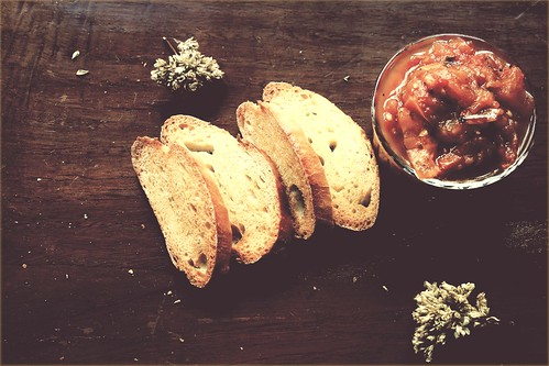 Crostini with Roasted Tomato and Garlic topping and Oregano Flowers