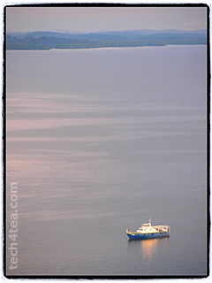 Lone boat at sunset in Sandakan port.