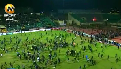 Footbrawl: Al Masry fans storm the pitch in their hundreds to fight with Al Ahly players