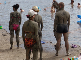 """People covered in """"healthy mud"""""""