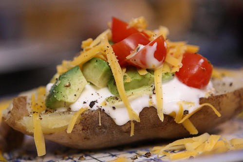 Oven Baked Potato with Avocado, Sour Cream, Tomato, and Cheddar