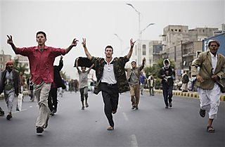Protestors run during a demonstration demanding the prosecution of Yemen's President Ali Abdullah Saleh in Sanaa, Yemen, Thursday, Nov. 24, 2011. by Pan-African News Wire File Photos