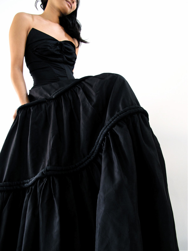 1950s Bustier gown with full skirt and thick piping accents