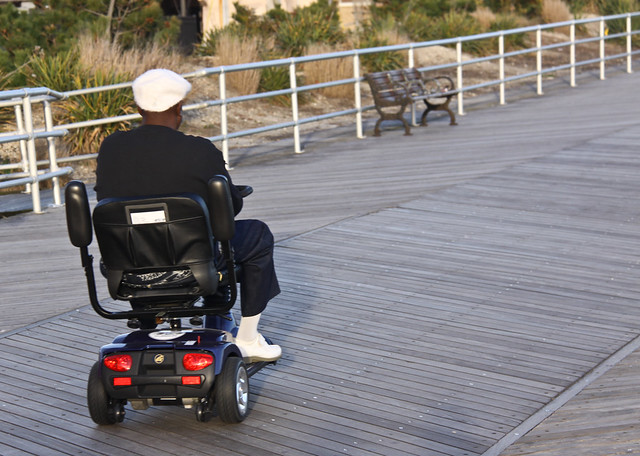 Man in an Electric Wheelchair and White Patent Leather Shoes - Atlantic City Boardwalk, NJ