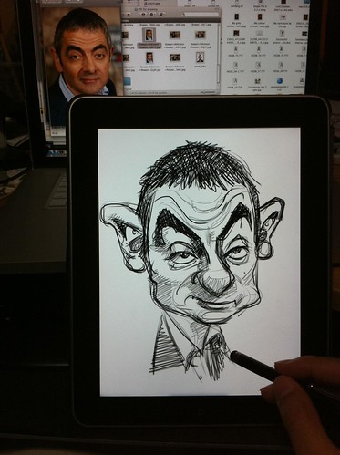 Mr Bean's caricature sketch on iPad Sketchbook Pro against the screen