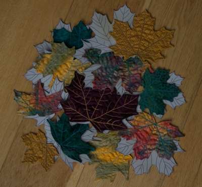 Quilted leaves, pictured with their templates, by Léan, December 2011