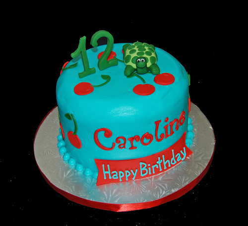 12th birthday cake with cherries and topped with a turtle