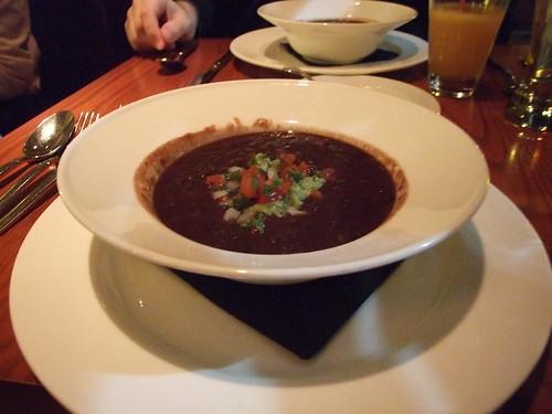 Chipotle black bean soup with tomato-avocado salsa