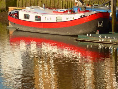 Red boat reflection