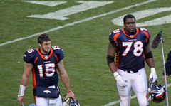 Tebow and Clady coming off the field
