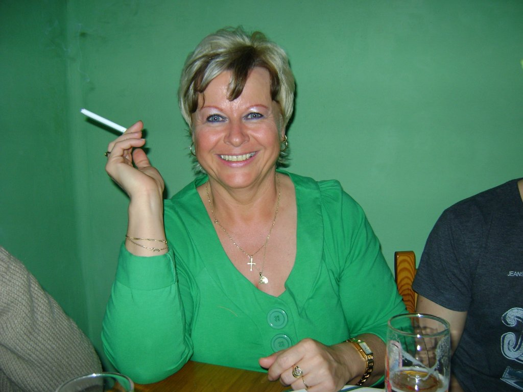 Mature woman smoking cigarette
