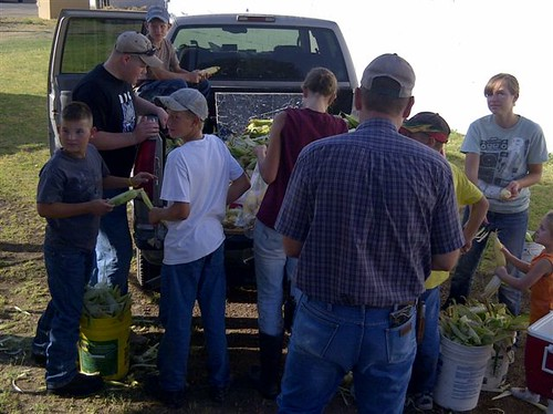 Loyal Doers 4-H Club members get produce ready for their community farmers market.  The market was started by the club as a response to the needs of the community, and helps teach members the fundamentals of agriculture and community involvement.  Photo by Bradley D. James