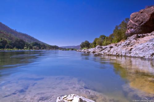 sky nature river landscape rocks hills