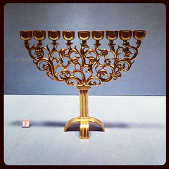wine glass(0.0), light fixture(0.0), sconce(0.0), glass(0.0), lighting(0.0), menorah(1.0), candle holder(1.0),