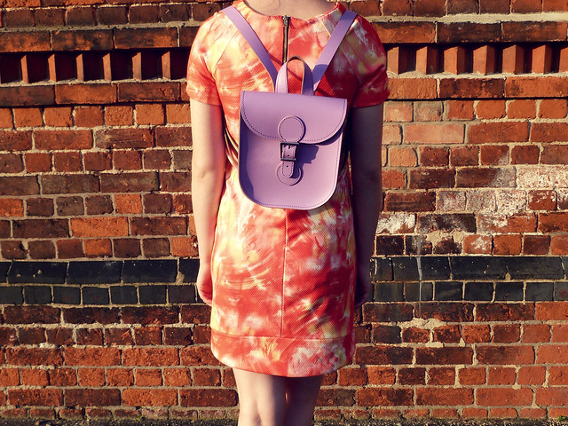 Orange shift dress | pastel purple rucksack