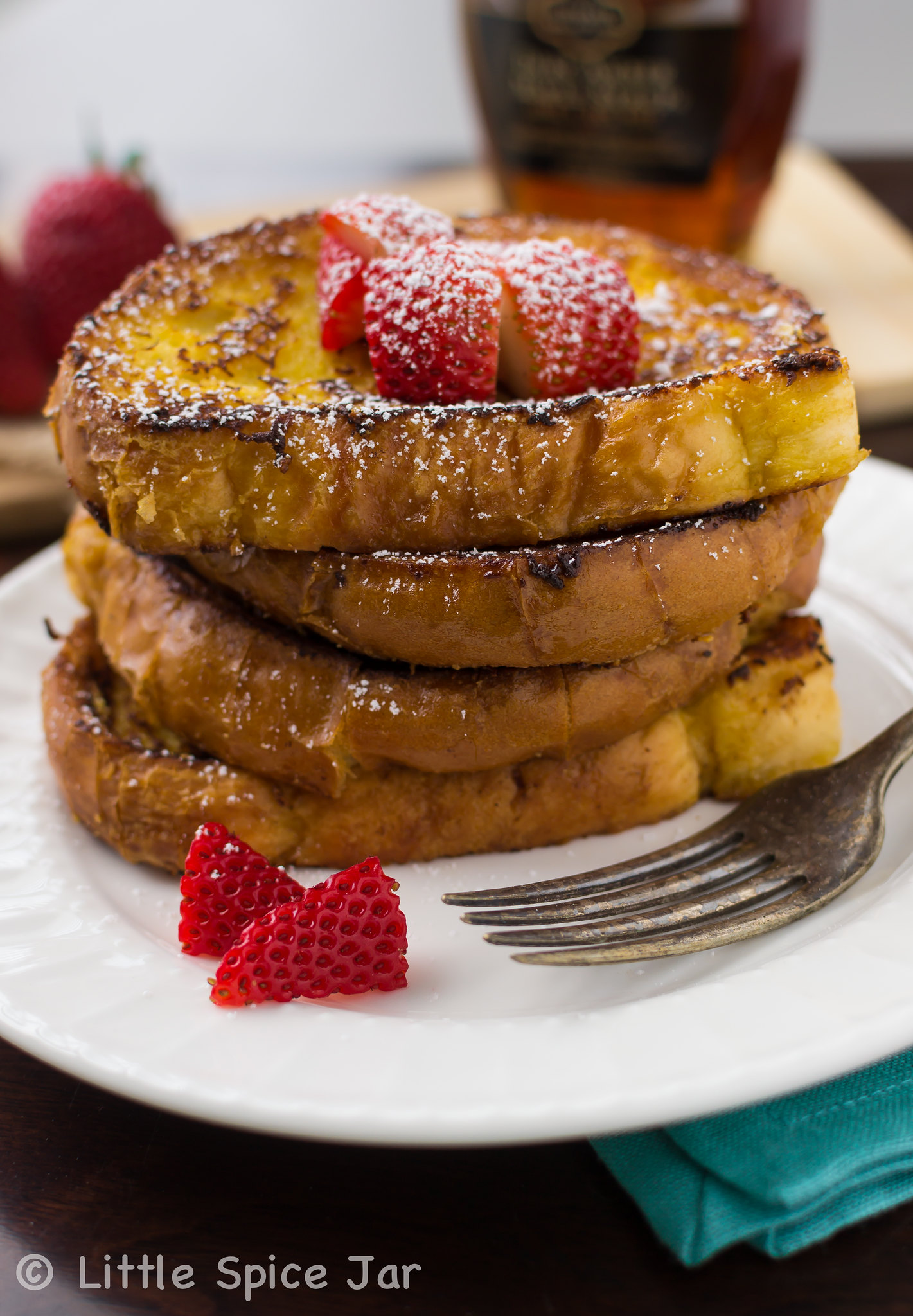 stack of French toast on white plate