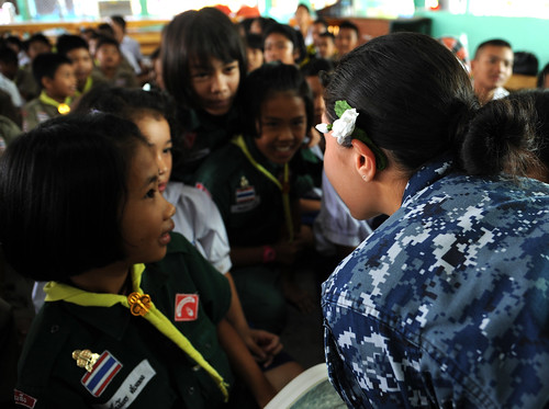 Quartermaster Seaman Aldannuvia Dominguez reads a fairytale book to Thai children.