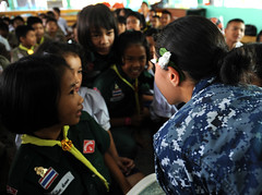 LAEM CHABANG, (Feb 23, 2012) Quartermaster Seaman Aldannuvia Dominguez, assigned to USS Germantown (LSD 42), reads a fairytale book to Thai children. (U.S. Navy photo by Mass Communication Specialist Seaman Raul Moreno Jr.)