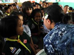 LAEM CHABANG, (Feb 23, 2012) Quartermaster Seaman Aldannuvia Dominguez, assigned to USS Germantown (LSD 42), reads a fairytale book to Thai children. (U.S. Navy photo by Mass Communication Specialist Seaman Raul Moreno Jr.)