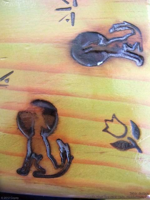 Branded, woodburned table design