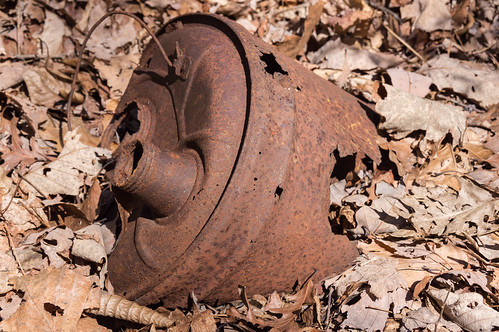 Rusty gas can on old trail