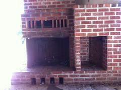 masonry oven(0.0), wood(0.0), iron(0.0), chimney(0.0), hearth(0.0), wall(1.0), fireplace(1.0), brick(1.0), brickwork(1.0),