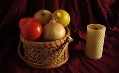 Beeswax candle, Still life with fruit and candle