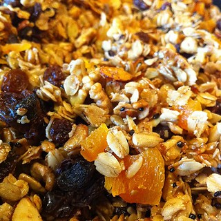 Granola: oats, wheat germ, black sesame, almonds, walnuts, raisins, dried apricots, honey, cinnamon, vanilla