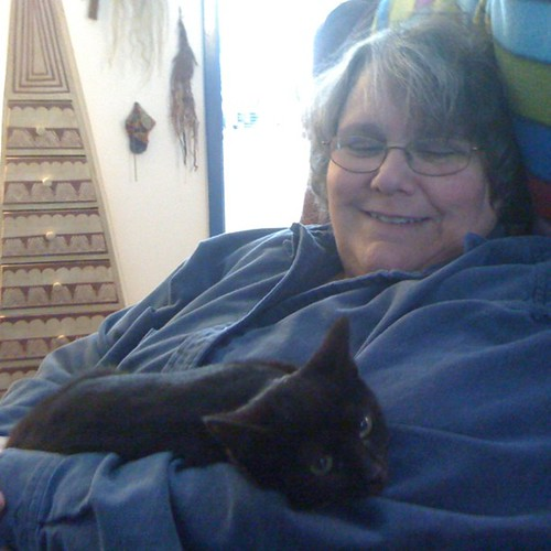 My mom with her new grandcat
