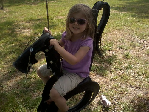 Riding the horsey swing at Page farm