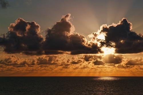 ocean light sea sky orange seascape water clouds evening ship glow atlantic