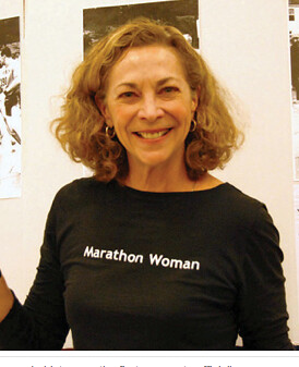 Kathrine Switzer wearing a black tshirt that reads Marathon Woman
