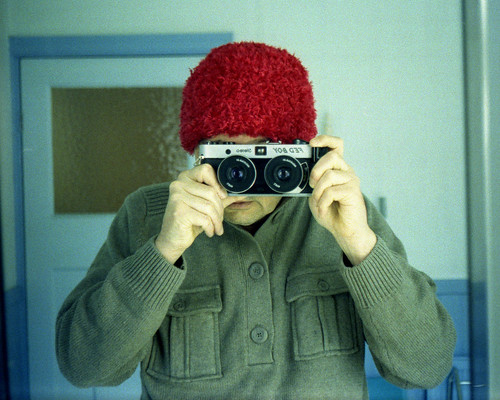 reflected self-portrait with FED-BOY camera and red hat by pho-Tony