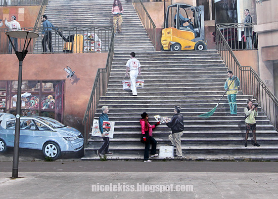 climbing the steps on Lyon mural