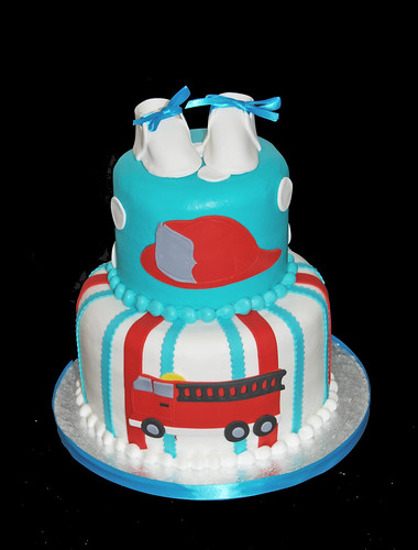 red and aqua fire truck themed baby shower cake