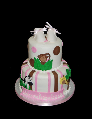 pink and brown jungle animal baby shower cake - monkey, giraffe, zebra