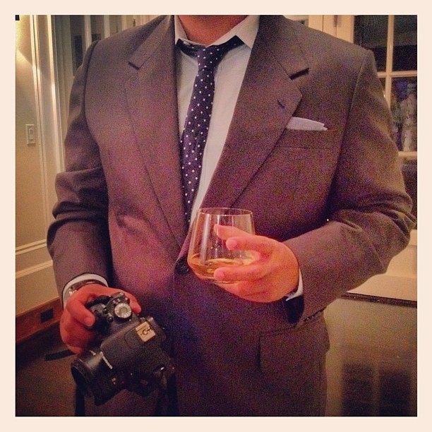 Mr. AN playing photog. Camera in one hand, scotch in the other #BRMadMen