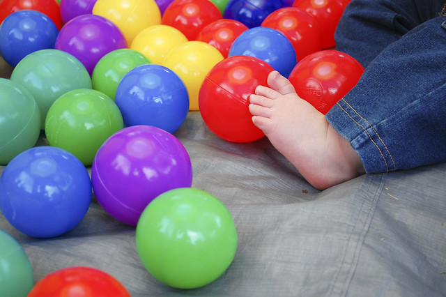 Baby feet and ball pit balls.