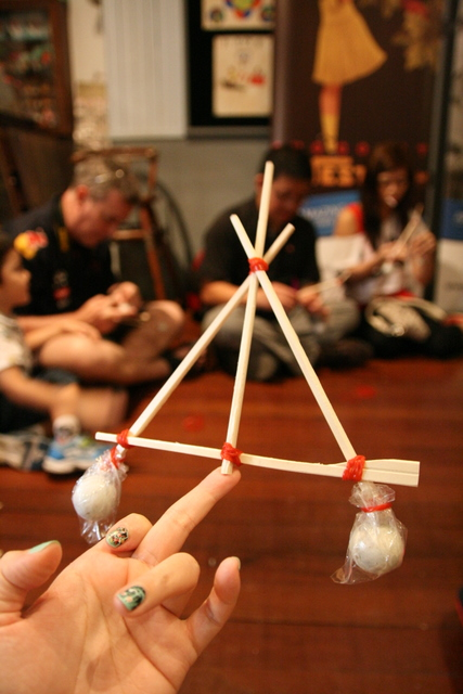 The self-balancing pyramid - you can make this easily from chopsticks, rubber bands and marbles