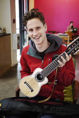 Mr. Aaron Enevoldsen with a stringed instrument in Vancouver, Canada