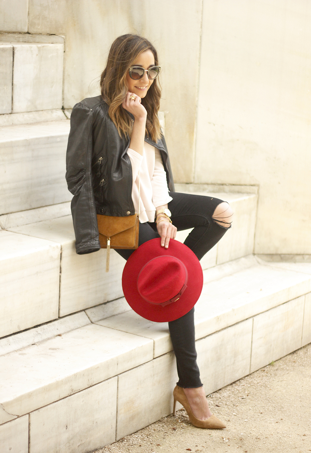 black biker jacket ripped jeans red hat camel bag outfit fashion style spring06