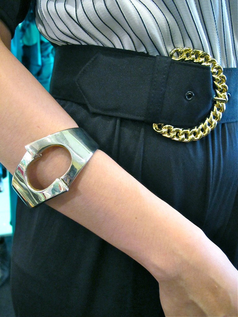 Mix silver with gold: A 1960s silver-tone mod bangle, and a 1980s belt with gold-tone buckle.