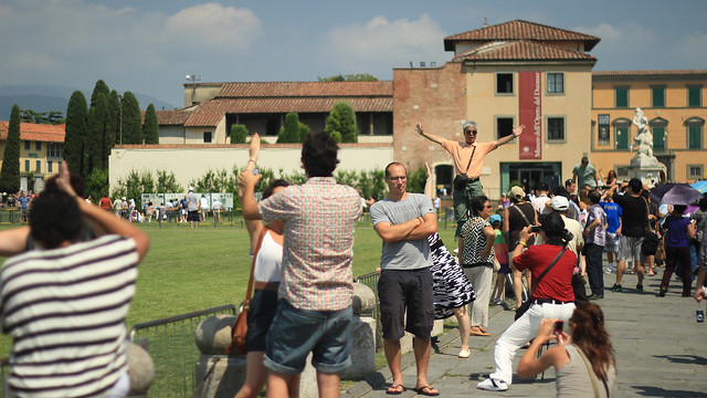 Tourists doing their thing in Pisa