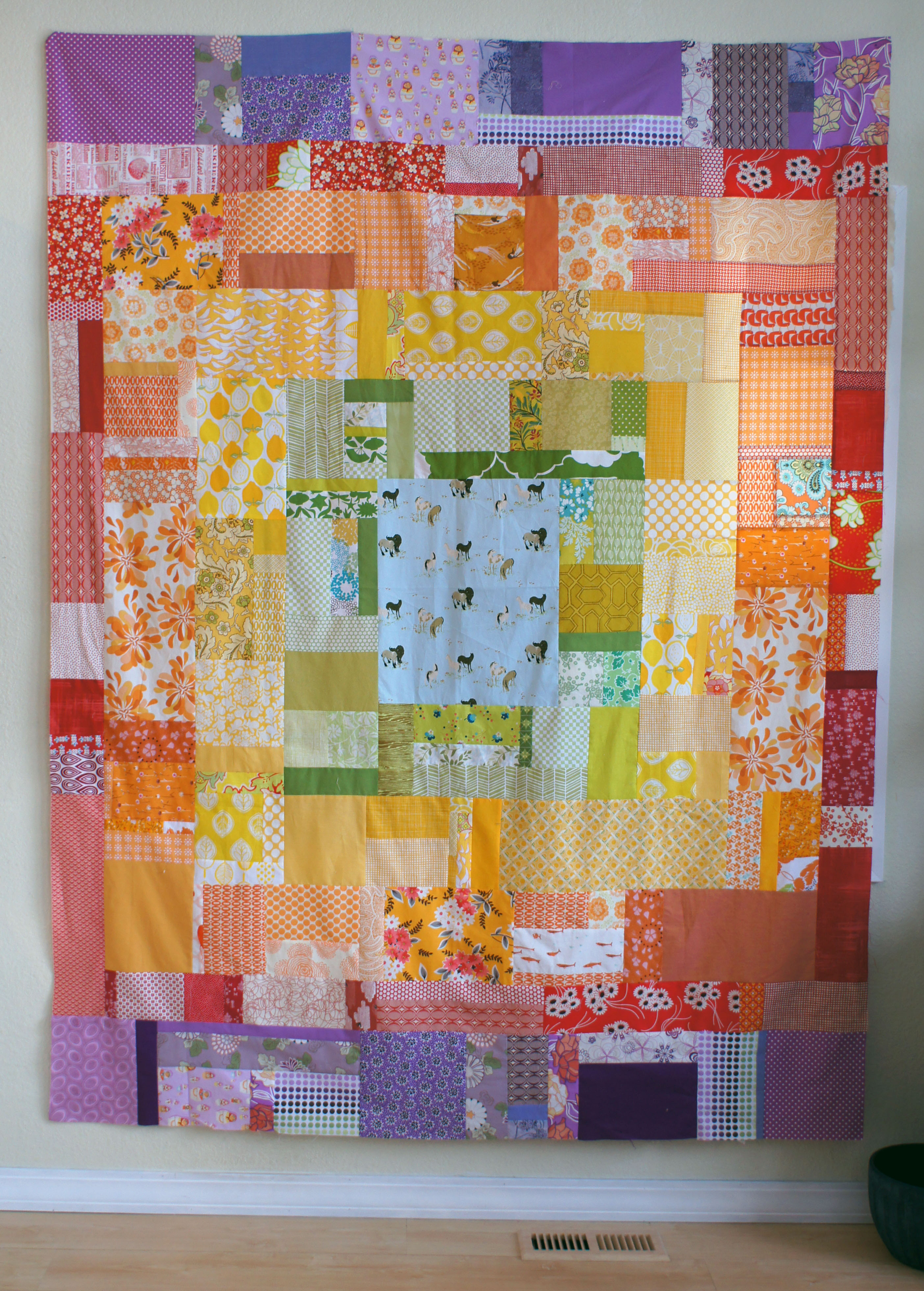 scrappy rainbow log cabin quilt