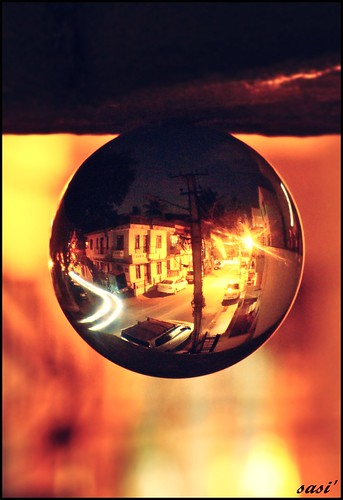 View of a street of bangalore through crystal in the evening by Sasi'