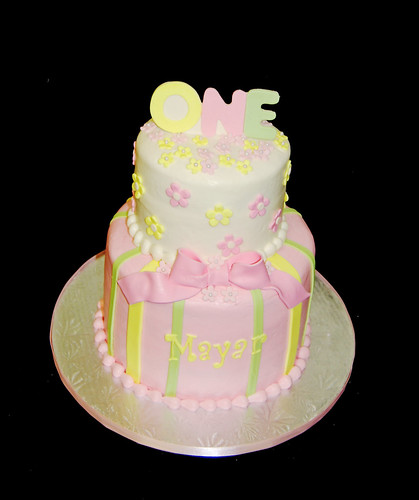 pink yellow and green 1st birthday cake